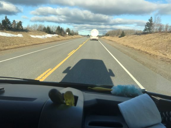 Picture of the van's shadow on the road ahead